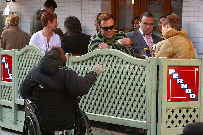 WWW.ACEPIXS.COM . . . . .  ....NEW YORK, APRIL 15, 2005....Mickey Rourke with a group of friends and little dog in tow, eat at Pastis. During the meal, Mickey Rourke is approached for money by a wheelchair bound homeless man. Then it's off to walk the dog.....Please byline: PAUL CUNNINGHAM - ACE PICTURES..... *** ***..Ace Pictures, Inc:  ..Craig Ashby (212) 243-8787..e-mail: picturedesk@acepixs.com..web: http://www.acepixs.com