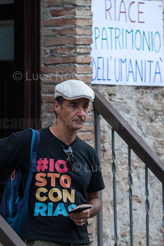 """Peppino Mazzotta (Actor & Artistic Director of RIACE in FESTIVAL).<br /> <br /> Riace (Calabria, Italy), 04/08/2018. Visiting Riace for the third day of the """"Riace in Festival"""", 'Festival delle Migrazioni e delle Culture Locali' (Festival of Migration and Local Cultures). Attending the festival, amongst others, were the Mayor of Napoli Luigi De Magistris and the Mayor of Barcelona Ada Colau, debating with the Mayor of Riace, Domenico 'Mimmo' Lucano, about the so called """"migration crisis"""", as well as the now famous """"Modello Riace"""" (The Riace Model: how to welcome and work with Migrants to invest in building a future together). Other speakers included: Tiziana Barillà, Journalist at """"il Salto"""" (1) and Author of the book """"Mimi Capatosta. Mimmo Lucano e il modello Riace"""" (2),  Magistrates Riccardo De Vito and Emilio Sirianni (in turn President and Member of Magistratura Democratica). Chair of the event was Ilaria Bonaccorsi, Historian & Journalist at """"il Salto"""".<br /> From the Festival website: """"RIACE in FESTIVAL, is an event born in the wake of the policy of reception and resettlement of refugees and asylum seekers that the city administration of the """"Riace Bronzes'"""" town has been implementing for years. [...] The festival aims to be a concrete initiative that, through the universal language of cinema and the arts, promotes the exchange and mutual knowledge to counteract forms of closure and racism, drawing attention to the innovative path that the municipal administration of Riace has started by combining the reception of migrants with the revival of its territory and giving the image of an unpublished Calabria, different from that of the black chronicle>>.<br /> Riace is a small village in the province of Reggio Calabria. It's famous because on the 16 August 1972 Stefano Mariottini, a chemist from Rome, found two full-size Greek bronzes... (Riace Bronzes: https://bit.ly/2oBoFNY)<br /> (For the full caption read the ARTICLE at the the beginning of this story)"""