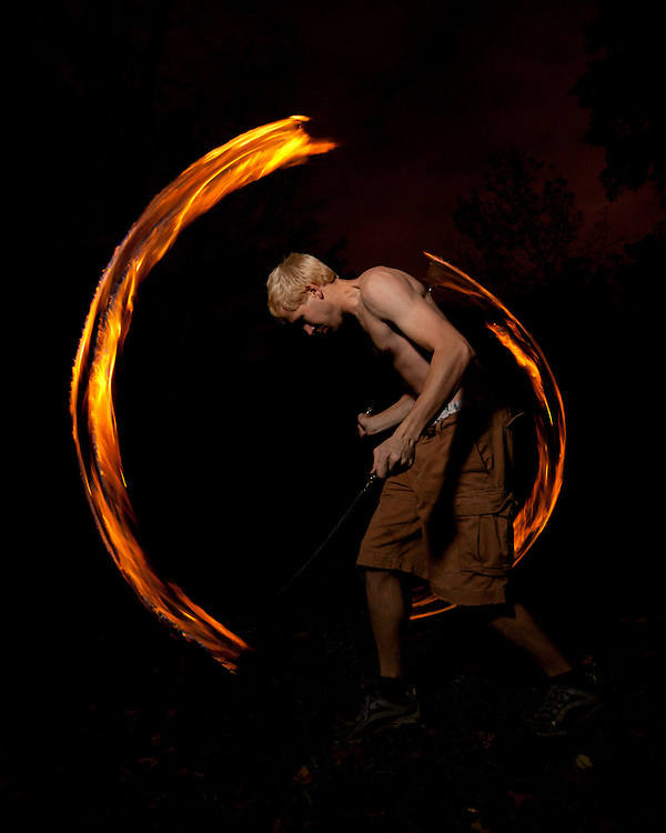 October 22, 2011 - Rochester Institute of Technology juggling club member DJ McLaughlin spins fire poi during the juggling club's semi-annual Juggle in the Park at Dark event at the Genesse Valley Park.