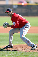 Loek Van Mil #59 of the Los Angeles Angels participates in pitchers fielding practice during spring training workouts at the Angels complex on February 16, 2011  in Tempe, Arizona. .Photo by:  Bill Mitchell/Four Seam Images.