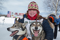 Denver Kay Evans with her lead dogs at the finish line of the 2016 Junior Iditarod in Willow, Alaska, AK  February 28, 2016
