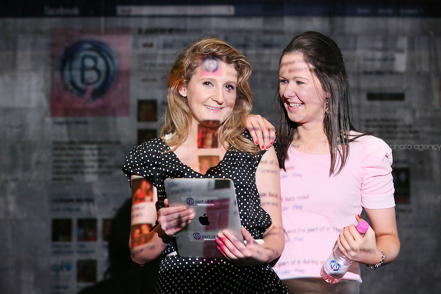 NO Repro Fee.27/10/2010.  Ballygowan Pink's B Part Of It campaign in support of Breast Cancer Awareness Month. Hundreds of UCD students got behind Ballygowan Pink's B Part Of It campaign in support of Breast Cancer Awareness Month. Pictured are Niamh Richardson from Dublin and  Regina Brady from Longford who posted messages of support to the life-sized Facebook Wall which was projected onto the entrance of UCD library. A live stream of students' messages was seen throughout the day to raise awareness of breast cancer and support the Marie Keating Foundation. Picture James Horan/Collins Photos