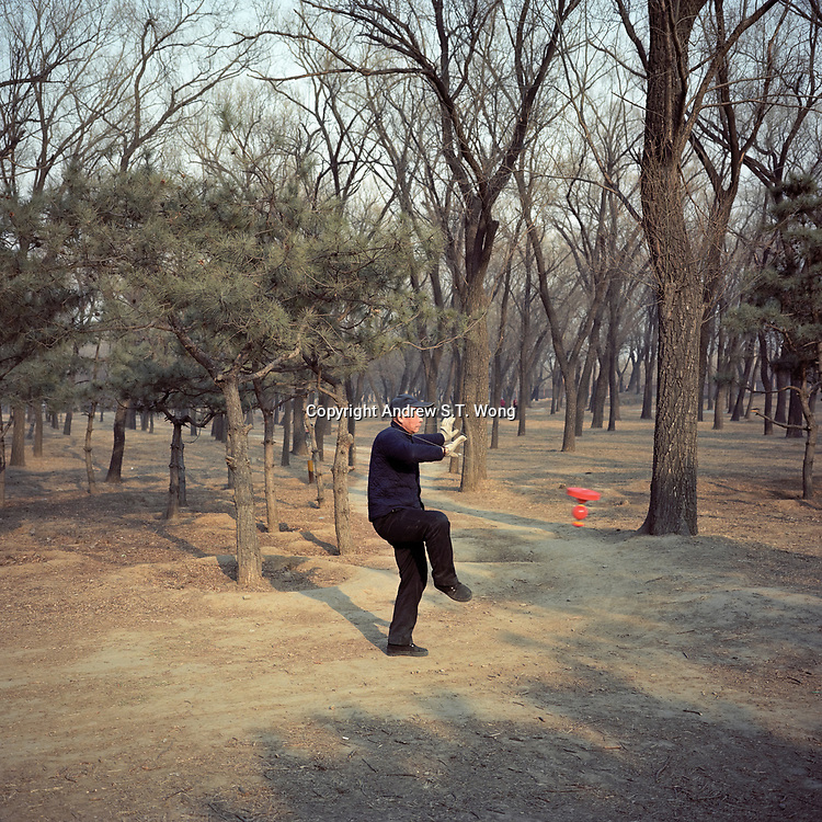 An elderly Chinese villager exercises at a woodland in his neighbourhood in Beijing, China, March, 2011.