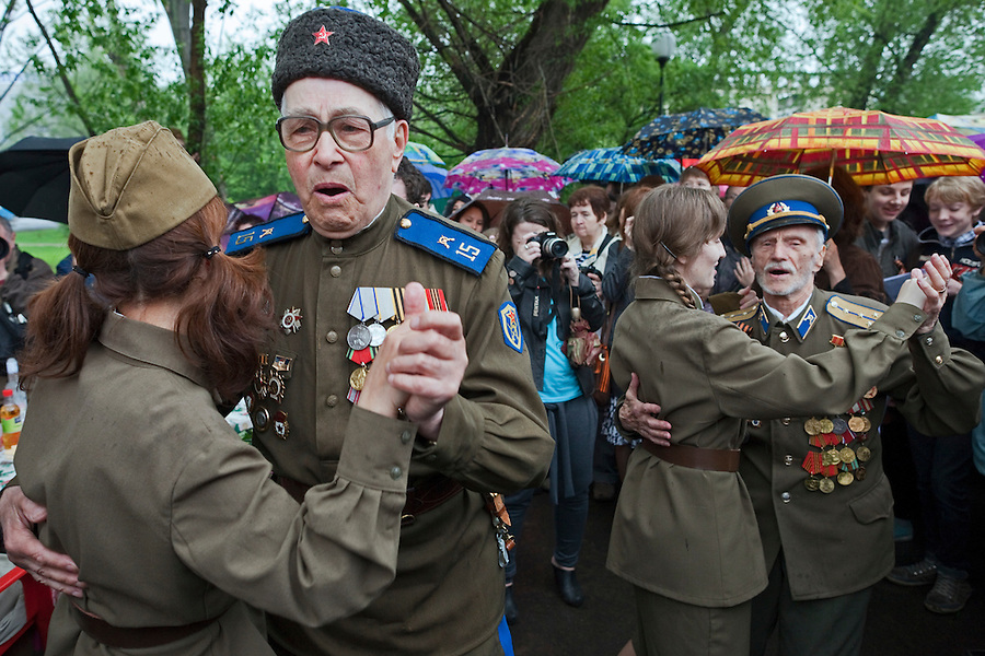 Moscow, Russia, 09/05/2012..Cossack army veterans dancing with women in World War Two era Soviet uniform as Russian World War Two veterans and well-wishers gather in Gorky Park during the countrys annual Victory Day celebrations.