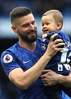 Chelsea's Olivier Giroud walks around the pitch with members of his family after the final whistle during Chelsea vs Watford, Premier League Football at Stamford Bridge on 5th May 2019