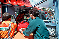 HEMS, helicopter emergency medical service, paramedics and doctors and ambulance crews load a patient into the helicopter on a stretcher to rush him to the crash room of the A&E department of a hospital. This image may only be used to portray the subject in a positive manner..©shoutpictures.com..john@shoutpictures.com