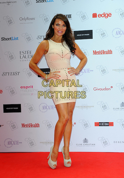 Lizzie Cundy.The FiFi UK Fragrance Awards 2012 at The Brewery, Chiswell Street, London, England..May 17th 2012.full length white cream dress hands on hips sleeveless .CAP/CJ.©Chris Joseph/Capital Pictures.