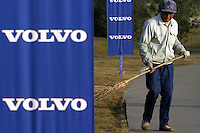 A club employee sweep the driveway before the start of the final round of the 2003 Volvo China Open Golf Tournament in Shanghai, China. The open is a major stop on the Asian PGA Tour..