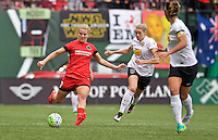 Portland, Oregon - Sunday October 2, 2016: Portland Thorns FC midfielder Lindsey Horan (7) kicks the ball away from Western New York Flash defender Alanna Kennedy (8) during a semi final match of the National Women's Soccer League (NWSL) at Providence Park.