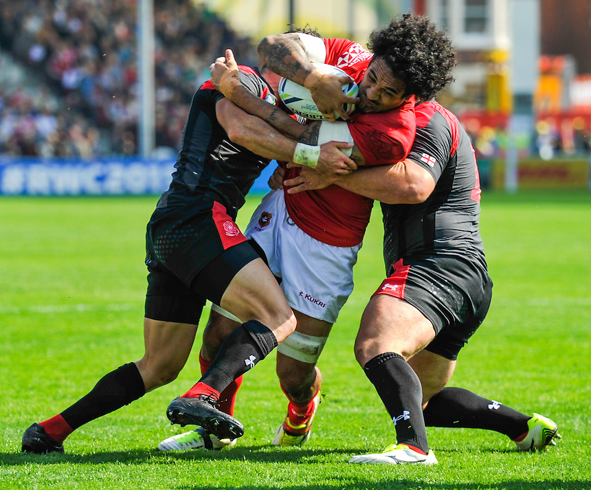 Tonga's Hale T-Pole is tackled by Georgia's Lasha Malaguradze and Levan Chilachava<br /> <br /> Photographer Craig Thomas/CameraSport<br /> <br /> Rugby Union - 2015 Rugby World Cup - 12;00  Georgia v Tonga - Saturday 19th September 2015 - Kingsholm - Gloucester <br /> <br /> &copy; CameraSport - 43 Linden Ave. Countesthorpe. Leicester. England. LE8 5PG - Tel: +44 (0) 116 277 4147 - admin@camerasport.com - www.camerasport.com