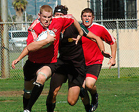 A member of San Diego State University's rugby team breaks away from a Colorado State University defender during the rugby match between the two Universites at the San Diego Invitational Rugby Tournament at Robb Field in Ocean Beach, Thursday February 7th 2008.  SDSU won the game by a score of 12 to 5.  The tournament is being held  in conjunction with the USA 7?s International Rugby at PETCO Park on February 9th & 10th..