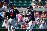 Atlanta Braves center fielder Ender Inciarte (11) high fives Charlie Culberson (8) after scoring a run in the top of the first inning during a Grapefruit League Spring Training game against the Detroit Tigers on March 2, 2019 at Publix Field at Joker Marchant Stadium in Lakeland, Florida.  Tigers defeated the Braves 7-4.  (Mike Janes/Four Seam Images)