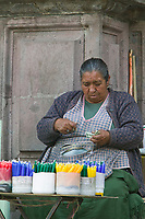 Candle vendor at church entrance, Quito, Ecuador