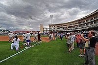 Jun. 23, 2009; Albuquerque, NM, USA; Media surrounds Albuquerque Isotopes outfielder Manny Ramirez as he stretches prior to the game against the Nashville Sounds at Isotopes Stadium. Ramirez is playing in the minor leagues while suspended for violating major league baseballs drug policy. Mandatory Credit: Mark J. Rebilas-