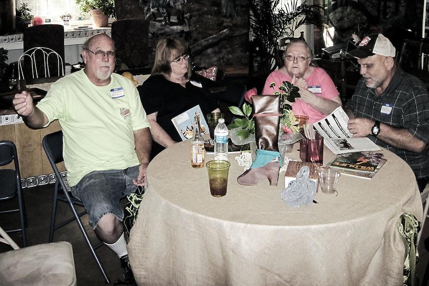 Cheeks at the round table, Omaha Beach treatment. Pocket camera shot.