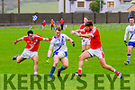 St Mary's Denis Daly sell a lovely dummy as he sends these two Corofin players colliding into each other in Cahersiveen on Saturday.