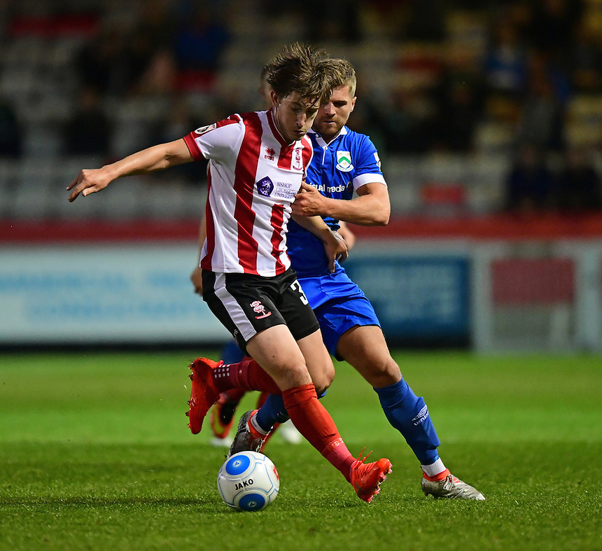 Lincoln City&rsquo;s Alex Woodyard is tackled by North Ferriby United's Ryan Kendall<br /> <br /> Photographer Chris Vaughan/CameraSport<br /> <br /> Football - Vanarama National League - Lincoln City v North Ferriby United - Tuesday 9th August 2016 - Sincil Bank - Lincoln<br /> <br /> &copy; CameraSport - 43 Linden Ave. Countesthorpe. Leicester. England. LE8 5PG - Tel: +44 (0) 116 277 4147 - admin@camerasport.com - www.camerasport.com