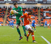 Portsmouth's Luke McGee gathers a ball ahead of Blackpool's Nathan Delfouneso<br /> <br /> Photographer Alex Dodd/CameraSport<br /> <br /> The EFL Sky Bet League One - Blackpool v Portsmouth - Saturday 11th November 2017 - Bloomfield Road - Blackpool<br /> <br /> World Copyright &copy; 2017 CameraSport. All rights reserved. 43 Linden Ave. Countesthorpe. Leicester. England. LE8 5PG - Tel: +44 (0) 116 277 4147 - admin@camerasport.com - www.camerasport.com