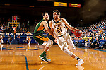 BROOKINGS, SD - DECEMBER 28:  Mike Daum #24 from South Dakota State makes a move past Dylan Miller #42 from North Dakota State during their game Wednesday night at Frost Arena in Brookings. (Dave Eggen/Inertia)