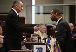 Nevada Sens. James Settelmeyer, R-Minden, left, and Aaron Ford, D-Las Vegas, talk on the Senate floor at the Legislative Building in Carson City, Nev., on Friday, April 3, 2015. <br /> Photo by Cathleen Allison