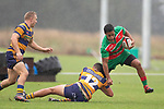 Apec Togafau gets tackled by Riley Hohepa. Counties Manukau Premier Club Rugby game between Waiuku and Patumahoe, played at Waiuku on Saturday April 28th, 2018. Patumahoe won the game 18 - 12 after trailing 10 - 12 at halftime. <br /> Waiuku Brian James Contracting 12 - Apec Togafau, Nathan Millar tries, Christian Walker conversion.<br /> Patumahoe Troydon Patumahoe Hotel 18 - Vernon Comley, Riley Hohepa tries, Riley Hohepa conversion, Riley Hohepa 2 penalties.<br /> Photo by Richard Spranger