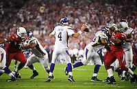 Dec 6, 2009; Glendale, AZ, USA; Minnesota Vikings quarterback (4) Brett Favre throws a pass in the third quarter against the Arizona Cardinals at University of Phoenix Stadium. The Cardinals defeated the Vikings 30-17. Mandatory Credit: Mark J. Rebilas-