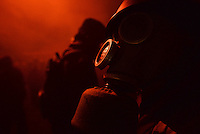A rioter wears a gas mask to protect himself by tear gas fired by the police during  protest against new draconian law to ban protests across the country.  Kiev. Ukraine