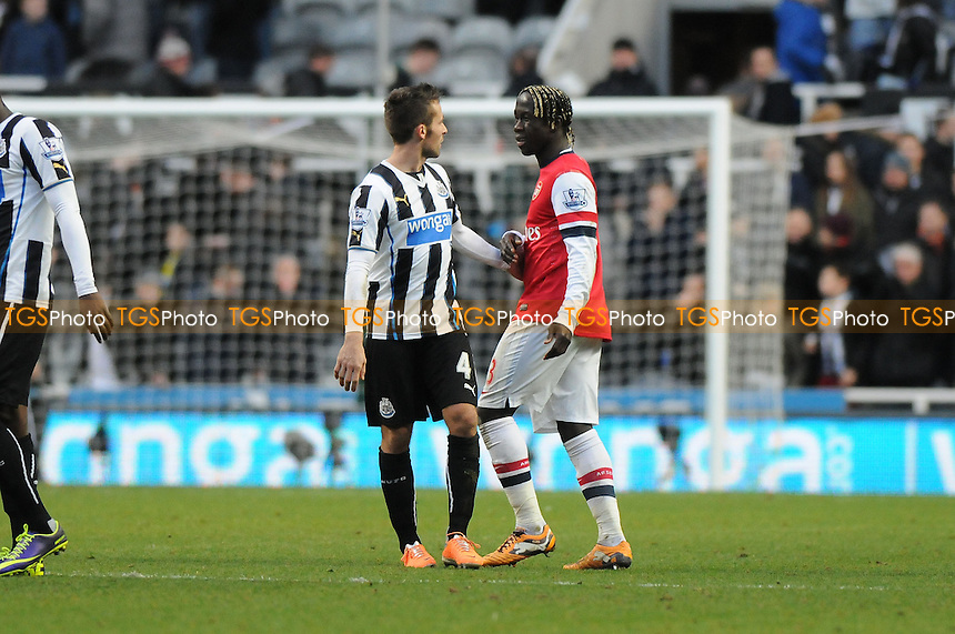 Yohan Cabaye of Newcastle United chats to Bacary Sagna of Arsenal at the final whistle - Newcastle United vs Arsenal - Barclays Premier League Football at St James Park, Newcastle upon Tyne - 29/12/13 - MANDATORY CREDIT: Steven White/TGSPHOTO - Self billing applies where appropriate - 0845 094 6026 - contact@tgsphoto.co.uk - NO UNPAID USE
