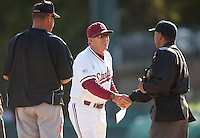 STANFORD, CA - April 12, 2011: Head coach Mark Marquess of Stanford baseball shakes hands with the home plate umpire before Stanford's game against Pacific at Sunken Diamond. Stanford won 3-1.