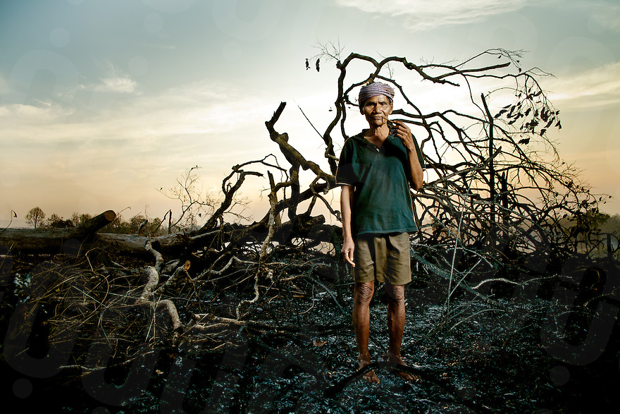 February 24, 2011 - Mondulkiri (Cambodia). An old Pnong man poses in front of burned trees in Pou Pring village. Indigenous people who live in this part of the country are among the most affected by logging, and the consequent loss of natural resources of which they are dependant upon. © Thomas Cristofoletti / Ruom