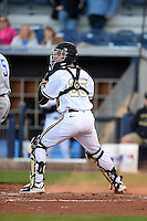 Vanderbilt Commodores catcher Karl Ellison (25) checks a runner during a game against the Indiana State Sycamores on February 20, 2015 at Charlotte Sports Park in Port Charlotte, Florida.  Vanderbilt defeated Indiana State 3-2.  (Mike Janes/Four Seam Images)