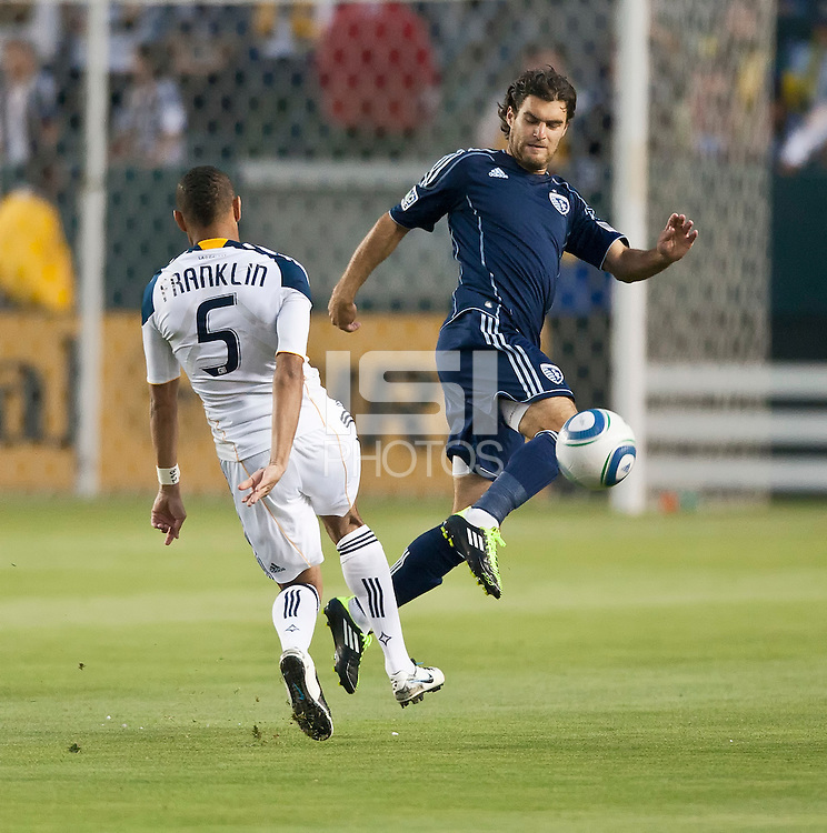 CARSON, CA – May 14, 2011: LA Galaxy defender Sean Franklin (5) tries to get the ball past Sporting KC Graham Zusi (8) during the match between LA Galaxy and Sporting Kansas City at the Home Depot Center in Carson, California. Final score LA Galaxy 4, Sporting Kansas City 1.