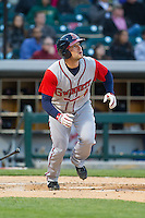 Steve Lerud (19) of the Gwinnett Braves starts down the first base line as he watches the flight of his solo home run against the Charlotte Knights at BB&T Ballpark on April 16, 2014 in Charlotte, North Carolina.  The Braves defeated the Knights 7-2.  (Brian Westerholt/Four Seam Images)
