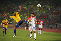 Brazil's Wellington Junior (15) makes a massive leap for the ball against Costa Rica's Diego Madrigal (11) during the FIFA Under 20 World Cup Semi-final match at the Cairo International Stadium in Cairo, Egypt, on October 13, 2009. Brazil won the match  1-0.