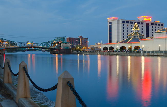 Harrah's Casino sits astride the DesPlaines River with the Cass Street Bridge in the background at Twilight from across the DesPlaines River in Bicentennial Park, Joliet, IL