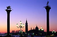 Italy, Venice. San Giorgio Maggiore and Piazzetta San Marco at dawnColumns of St.Theadore and Winged Lion of St. Mark'