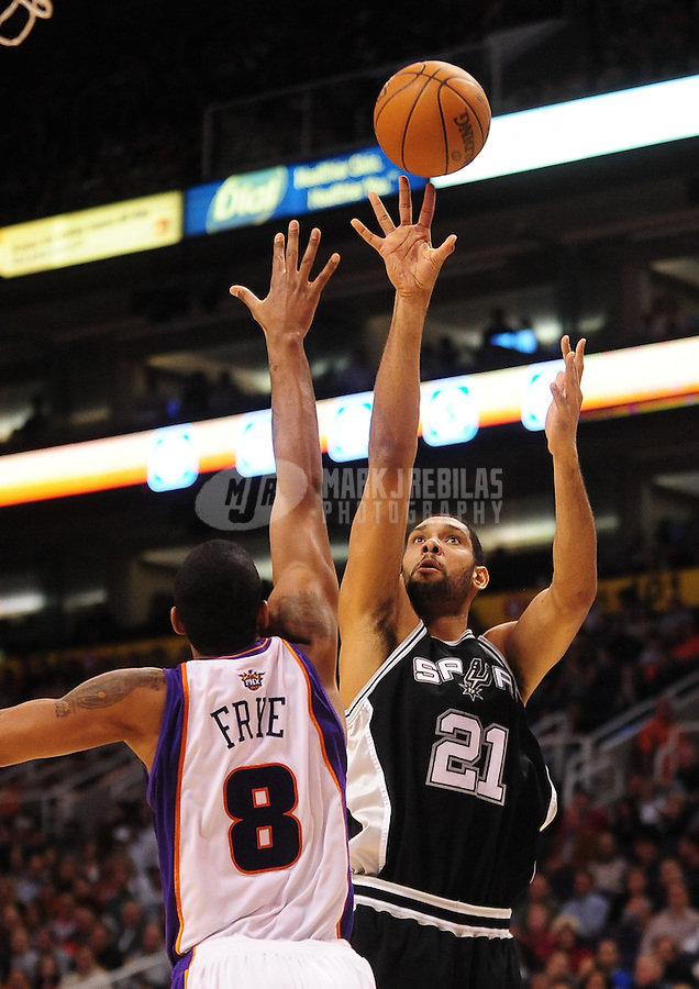 Dec. 15, 2009; Phoenix, AZ, USA; San Antonio Spurs forward (21) Tim Duncan shoots under pressure from Phoenix Suns center Channing Frye at the US Airways Center. The Suns defeated the Spurs 116-104. Mandatory Credit: Mark J. Rebilas-