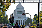The car carrying Japanese Emperor Naruhito and Empress Masako passes in front of the diet building during the royal motorcade in Tokyo, Japan on Sunday, November 10, 2019. (Photo by AFLO)