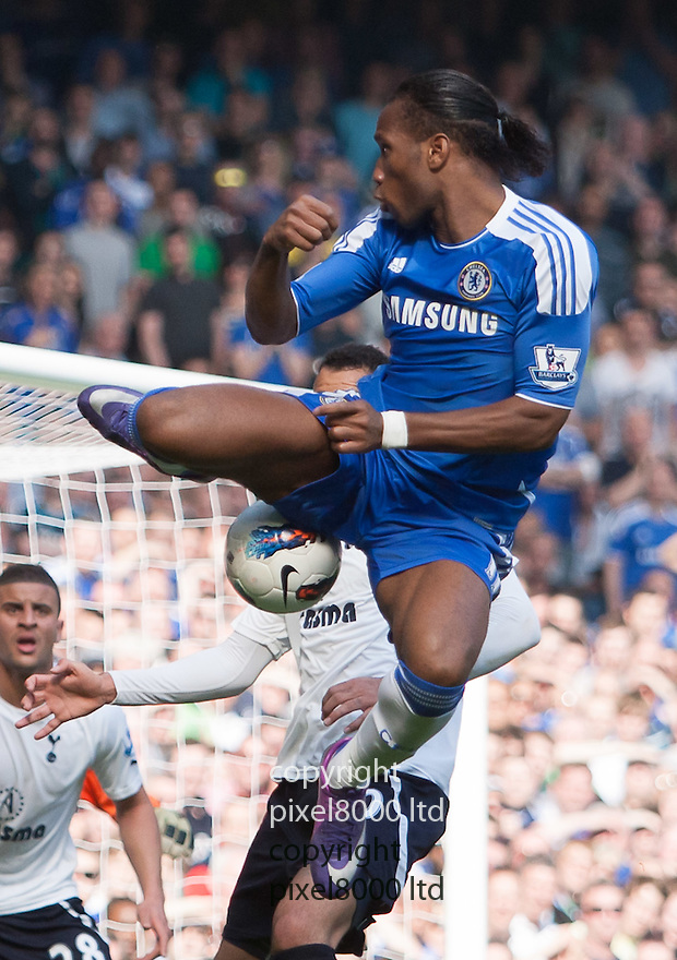 London, UK. Chelsea striker Didier Drogba lays a ball during Barclays Premier League fixture Chelsea versus Tottenham Hotspur at Stamford Bridge 24 Mar.  Byline David Fearn Pixel 8000 Ltd