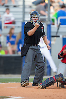 Home plate umpire Garon Keuten makes a strike call during the Appalachian League game between the Elizabethton Twins and the Kingsport Mets at Hunter Wright Stadium on July 9, 2015 in Kingsport, Tennessee.  The Twins defeated the Mets 9-7 in 11 innings. (Brian Westerholt/Four Seam Images)