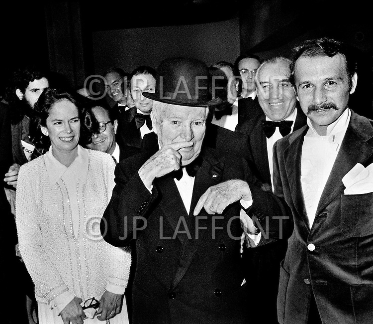 New York City, USA. April 15th, 1972 . Charlie Chaplin and his wife Oona attending a performance at the Philharmonic Hall. Chaplin is imitating his trademark mustache.
