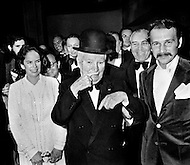 Hollywood, Los Angeles, California, USA. April 15th, 1972 . Charlie Chaplin and his wife Oona attending a performance at the Philharmonic Hall. Chaplin is imitating his trademark mustache after receiving a Honorary Academy Award for his career.