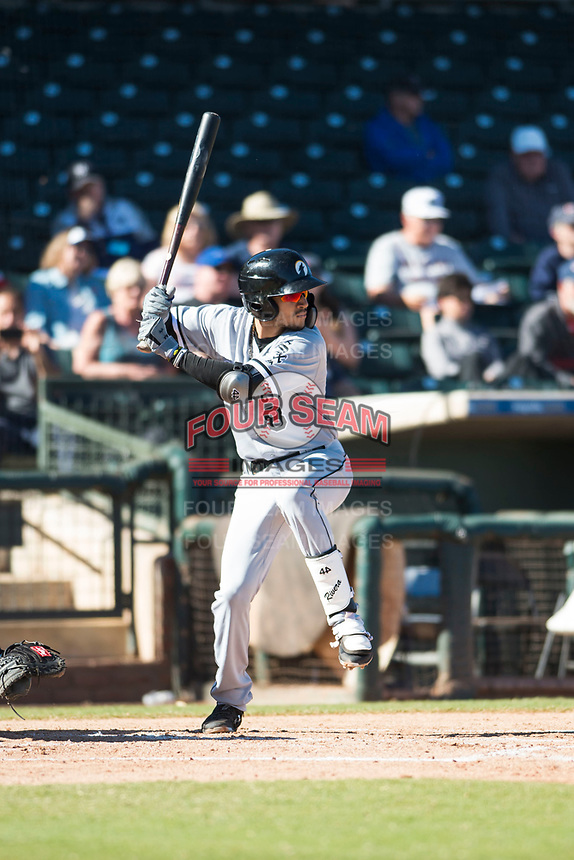 Glendale Desert Dogs shortstop Laz Rivera (8), of the Chicago White Sox organization, at bat during an Arizona Fall League game against the Surprise Saguaros at Surprise Stadium on November 13, 2018 in Surprise, Arizona. Surprise defeated Glendale 9-2. (Zachary Lucy/Four Seam Images)