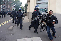 PH: Rick Findler..08.08.11 Police forcefully remove a local photographer as youths and police clash in Hackney today as riots spread across the whole of London including Croydon and Clapham.