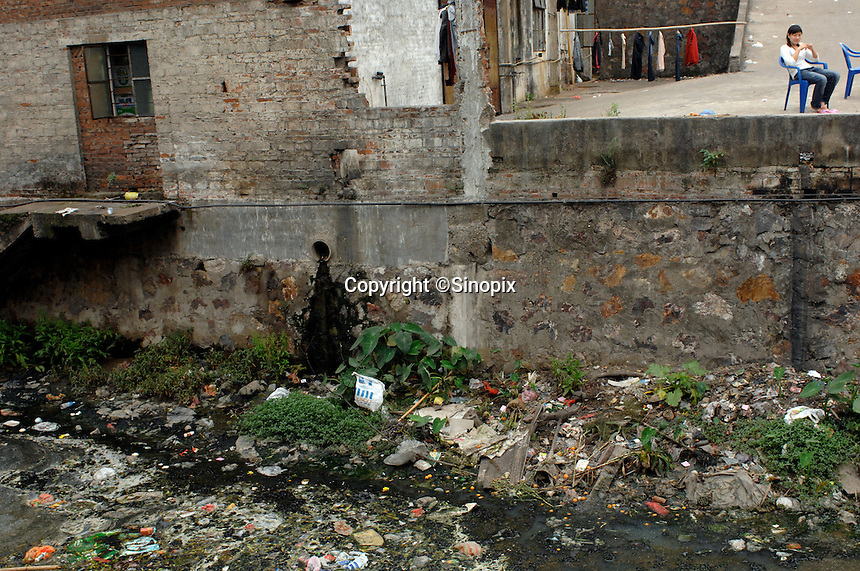 Carrier bags from the British supermarket chain Tesco contribute to horrendous pollution of a stream in Mai Village in Shunde district of Guangdong, China. Italian, Dutch and British waste was found to being re-cycled in the area..15 Mar 2007