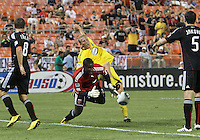 Bill Hamid #28 of D.C. United drops the ball after a collision with Steven Lenhart #32 of the Columbus Crew during a US Open Cup semi final match at RFK Stadium on September 1 2010, in Washington DC. Columbus won 2-1 aet.