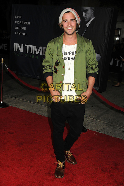 Spencer Falls.The Regency Enterprises L.A. Premiere of 'In Time' held at The Regency Village Theatre in Westwood, California, USA..October 20th, 2011.full length jacket black jeans denim white stubble facial hair green grey gray hat knitted .CAP/ADM/BP.©Byron Purvis/AdMedia/Capital Pictures.