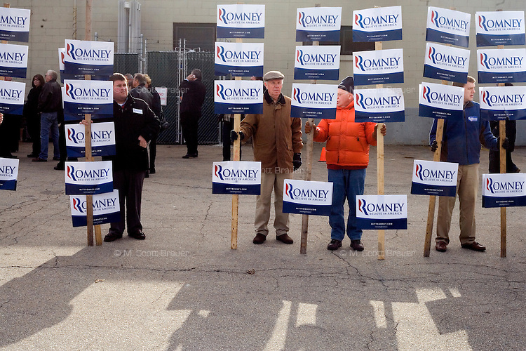 Mitt Romney supporters wait for a Romney campaign event to begin at Gilchrist Metal Fabricating in Hudson, New Hampshire, on Jan. 9, 2012.  Romney is seeking the 2012 Republican presidential nomination.