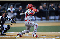 Justin Jordan (22) of the Sacred Heart Pioneers follows through on his swing against the Wake Forest Demon Deacons at David F. Couch Ballpark on February 15, 2019 in  Winston-Salem, North Carolina.  The Demon Deacons defeated the Pioneers 14-1. (Brian Westerholt/Four Seam Images)