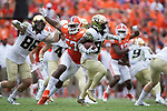 Greg Dortch (89) of the Wake Forest Demon Deacons avoids the pursuit of Tre Lamar (57) of the Clemson Tigers as he returns a punt during second half action at Memorial Stadium on October 7, 2017 in Clemson, South Carolina.  The Tigers defeated the Demon Deacons 28-14. (Brian Westerholt/Sports On Film)